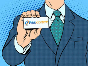 J. Man holding iweb business card